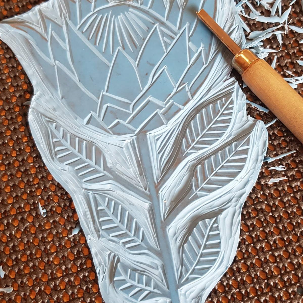 Lino printing block with a protea flower